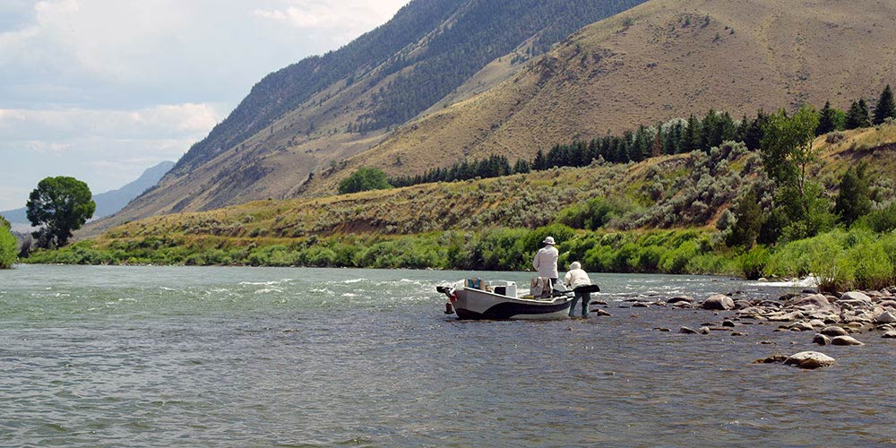 Guide and client working a riffle corner on a Yellowstone River float trip
